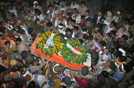 Indian soldier beheaded - coffin carried by people