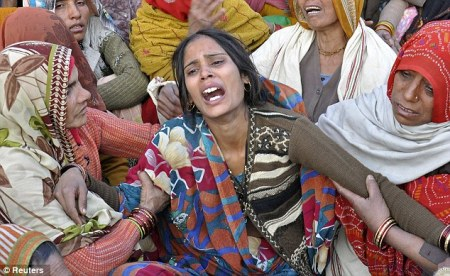Indian soldier beheaded - wife cries demands for head