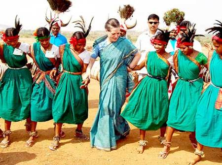 UPA Chairperson Sonia Gandhi dances with tribal women at Kutagudam in Khammam district of Andhra Pradesh
