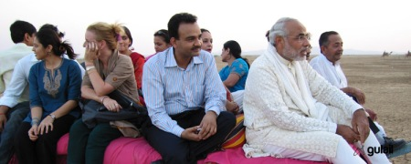 Modi riding on a cart at the Kutch Ustav