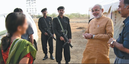 Modi with Mathuri and the police officer 2013