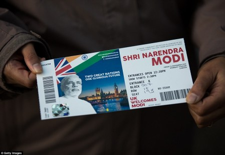 A woman proudly shows off her ticket to the event, which saw crowds of supporters descending on Wembley this evening