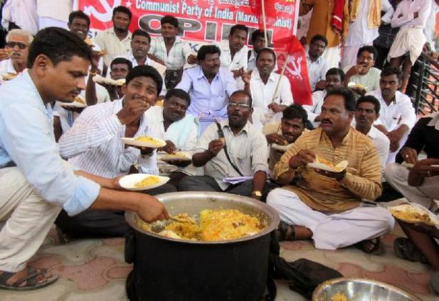 CPI-ML- activists consuming beef outside the Tahsildar office in Sindhanur on Thursday -05-11-2015- Photo-SANTOSH SAGAR.